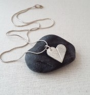 Eco silver heart pendant with leaf pattern