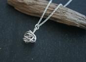 Silver wire twist pendant