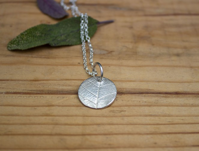 Circle silver clay leaf pattern pendant