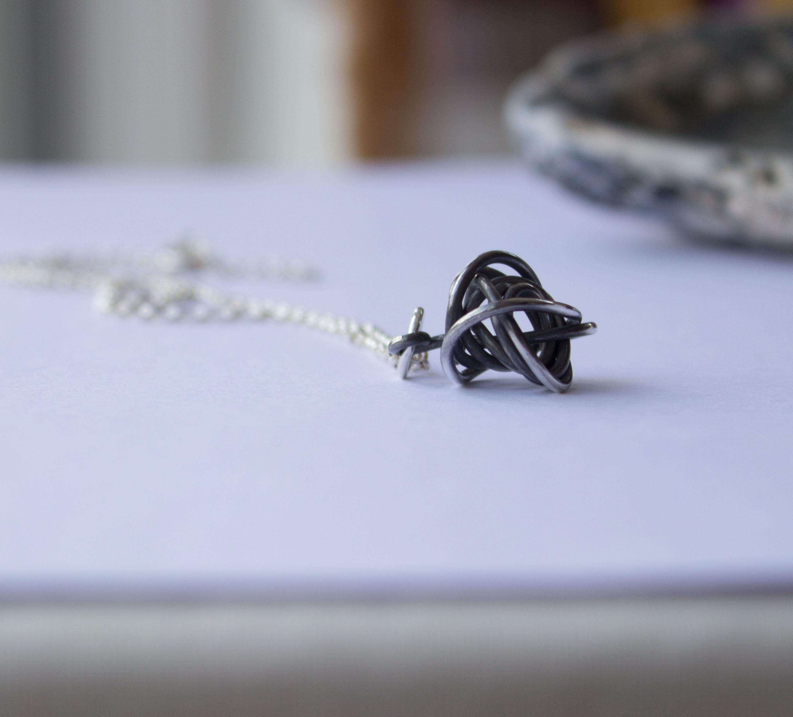 Silver wire twist birds nest pendant artisan jewellery